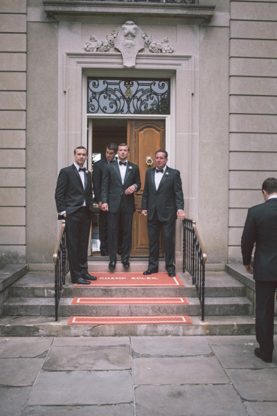 groomsmen in back tuxedos heading to wedding ceremony