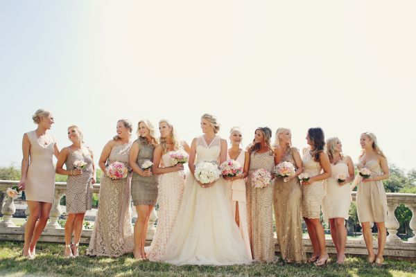 bride standing next to bridesmaids in short short sequin dresses