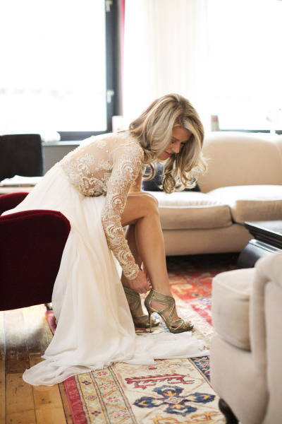 bride putting on jimmy choo's