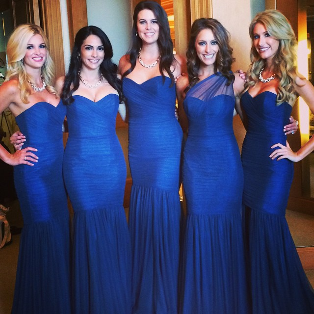 bridesmaids in strapless fitted royal blue bridesmaid dresses