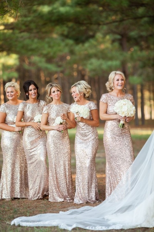 bridesmaids in long gold sequin bridesmaid dresses with cap sleeves
