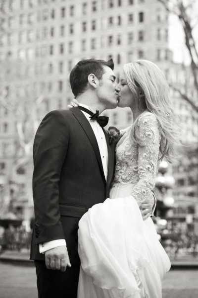 bride and groom kiss outside in new york city