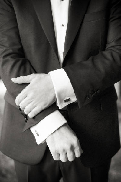 groom adjusting cuffs