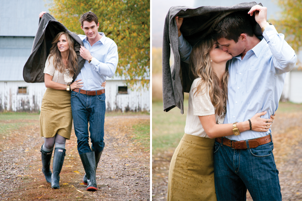 guy holding jacket over girl to protect her from the rain as they kiss