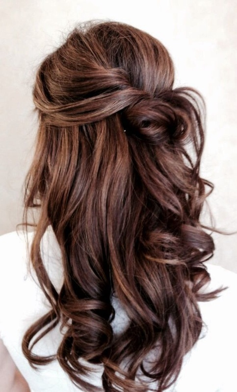twisted half up wedding hair with loose curls