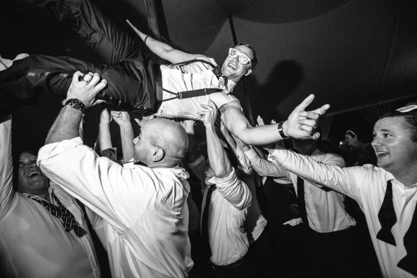 groomsmen carrying groom on the dance floor