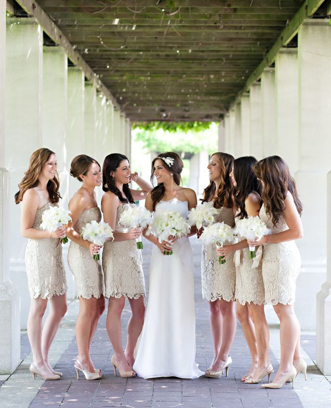 bride with bridesmaids in nude lace short dresses