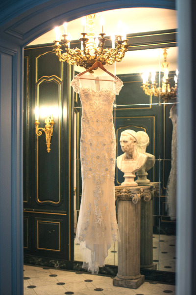 wedding dress handing in mansion hallway