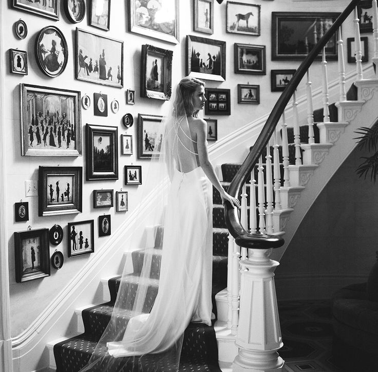 bride on staircase in low back wedding dress