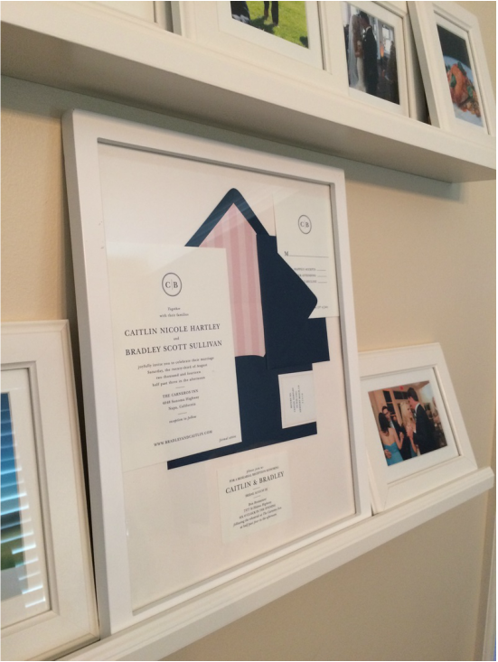 Framed Wedding Invitations On Picture Ledge