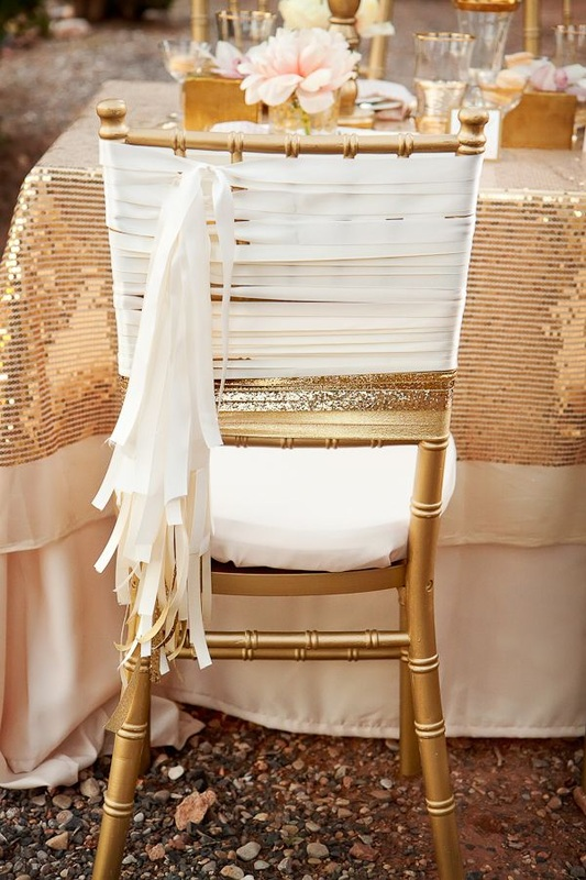 gold wedding chair with white tassels