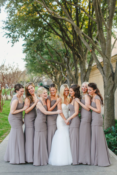 bride next to bridesmaids in beige bridesmaid dresses by watters