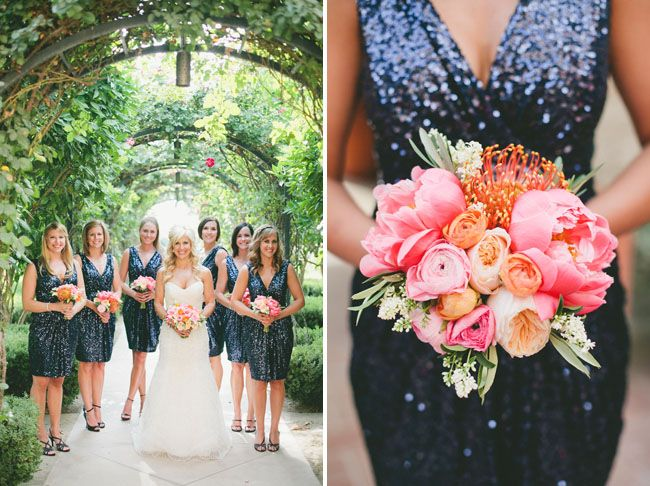 bride next to bridesmaids in navy sequin dresses