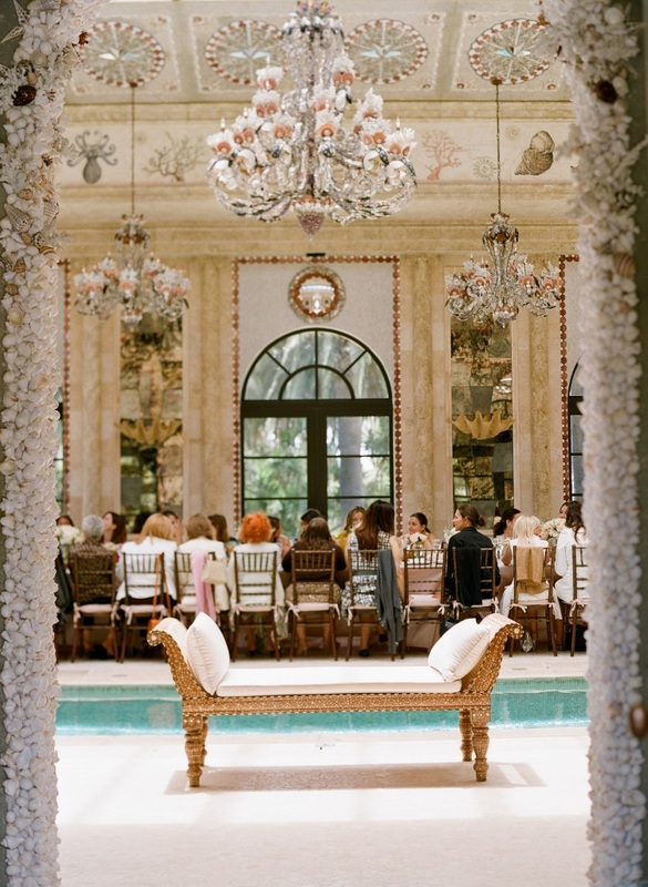 bridal shower brunch in outdoor pool room with chandeliers