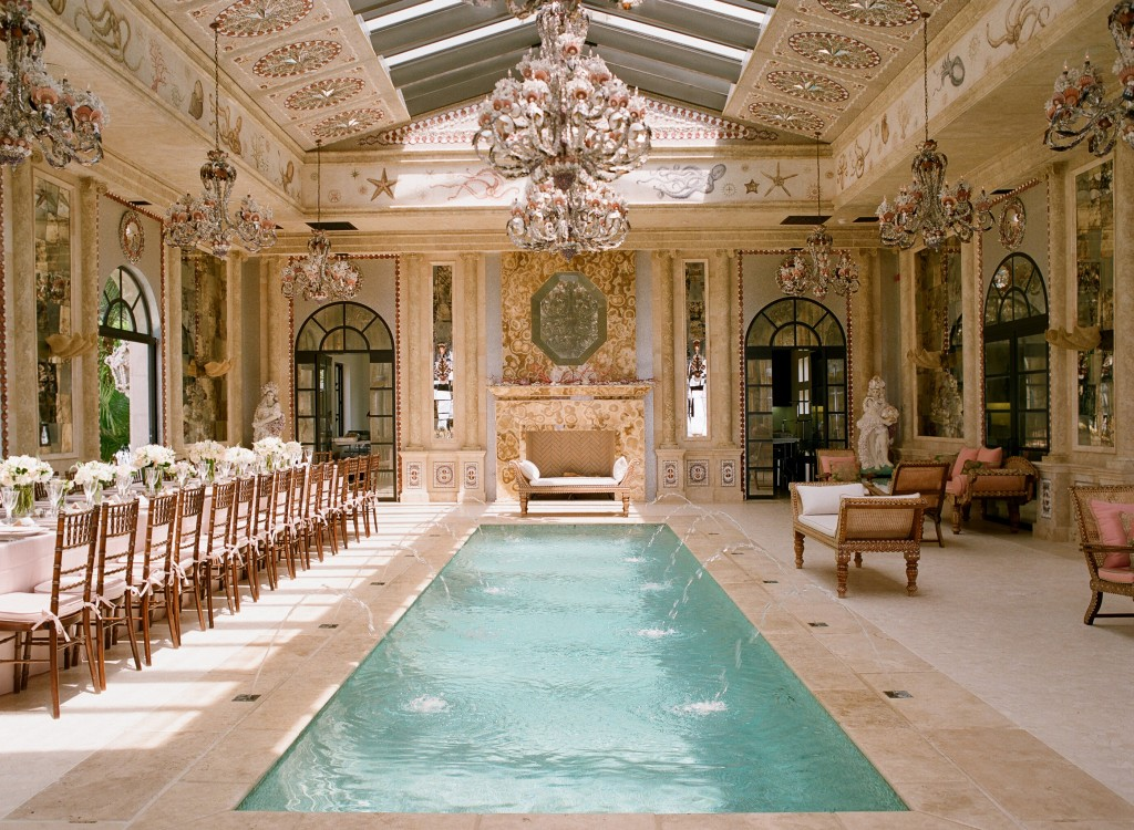 mansion indoor pool room with elegant kings reception table