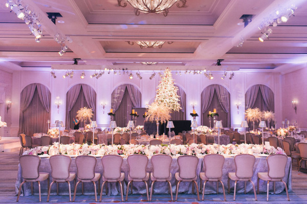 wedding reception with purple uplights, and white and pink low centerpieces