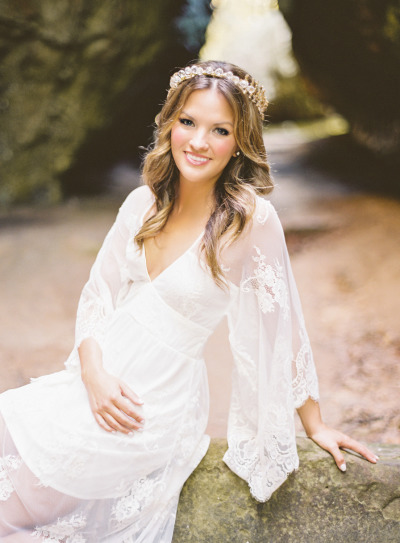 Becca Tilley from The Bachelor in a white lace dress and gold halo crown