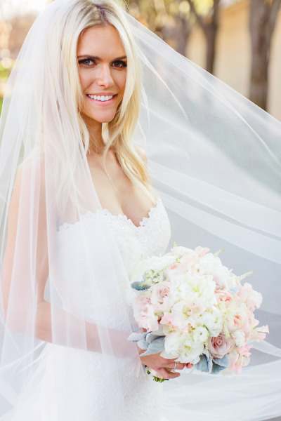 lauren scruggs in wedding dress holding gorgeous bouquet of white and blush florals