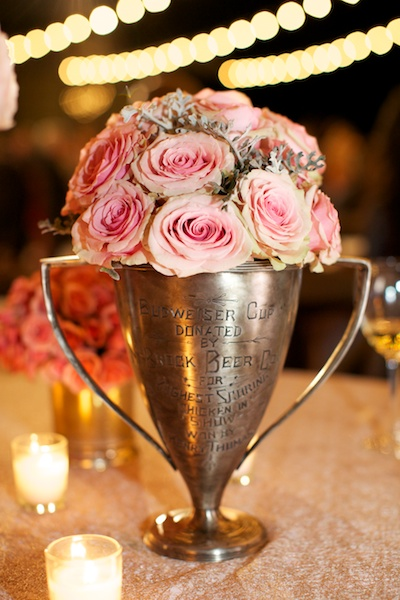 large silver cup filled with pink roses