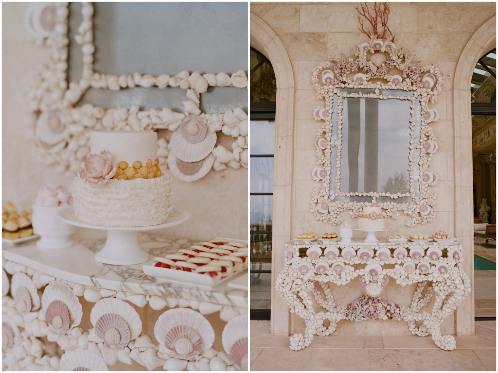 cake table surrounded by shells