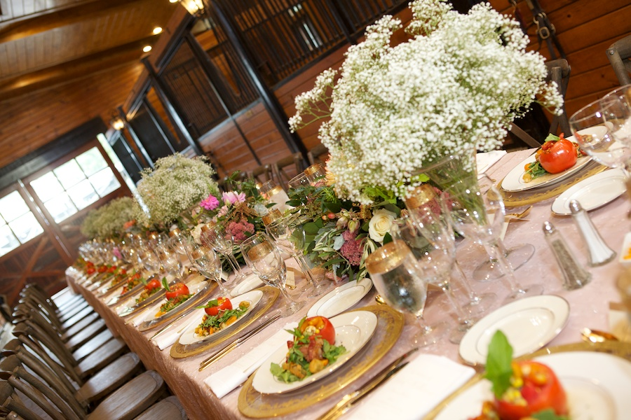 wedding reception table set up in a barn