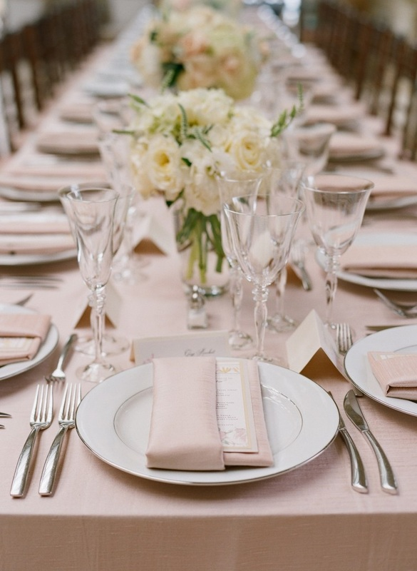 blush table linens with white bouquets