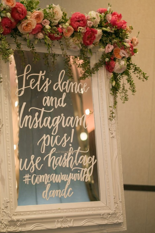 wedding hashtag, let's dance and instagram pics written on framed mirror