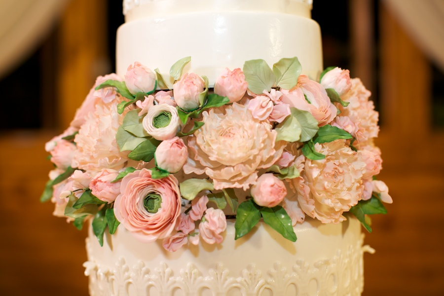 pink mini flowers on white cake