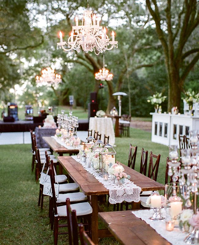 outdoor wedding reception outdoor tables, bar and dance floor with hanging chandeliers