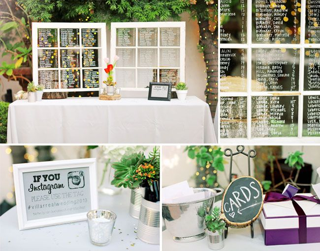 wedding seating chart written on white vintage windows