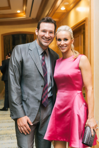 Eli Manning and wife as guests at a wedding, short hot pink dress