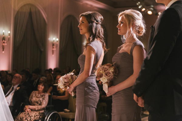 bridesmaids standing at the alter in grey watters bridesmaid dresses