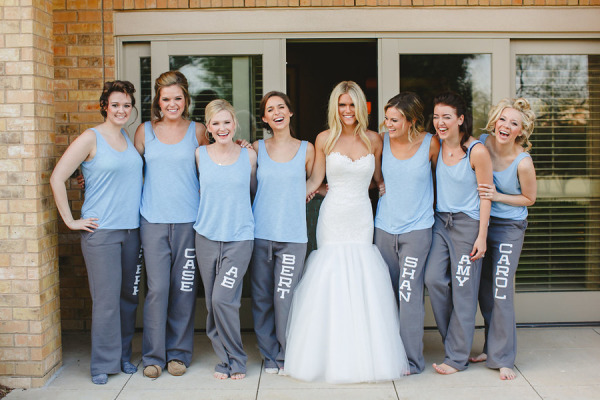lauren scruggs in wedding dress and bridesmaids in matching sweats with their names on them