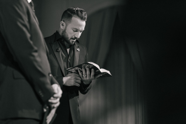 officiant reading during wedding ceremony Rich Wilkerson Jr.