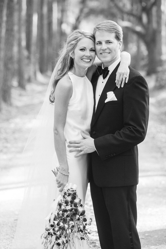 Cameran Eubanks and Dr. Jason Wimberly on hugging on wedding day
