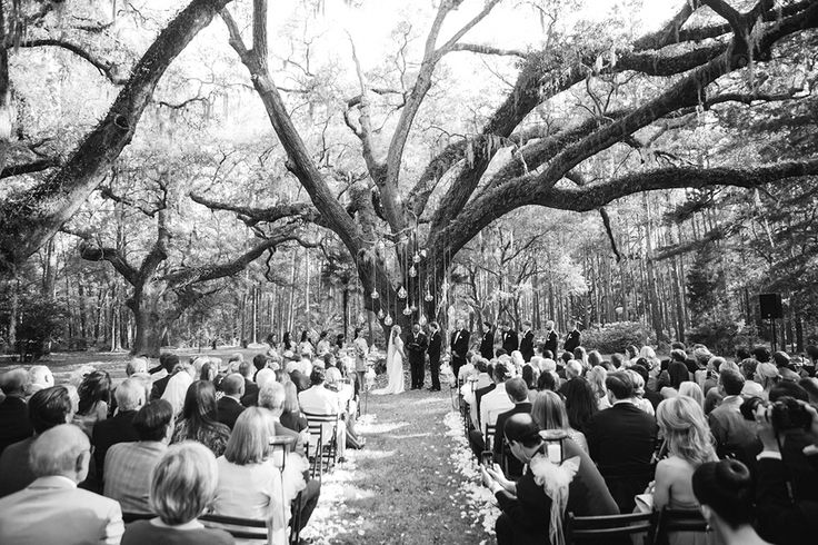 black and white photo of outdoor ceremony in progress