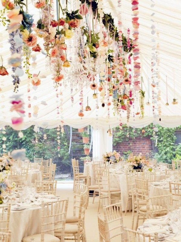 white wedding reception tent with hanging florals
