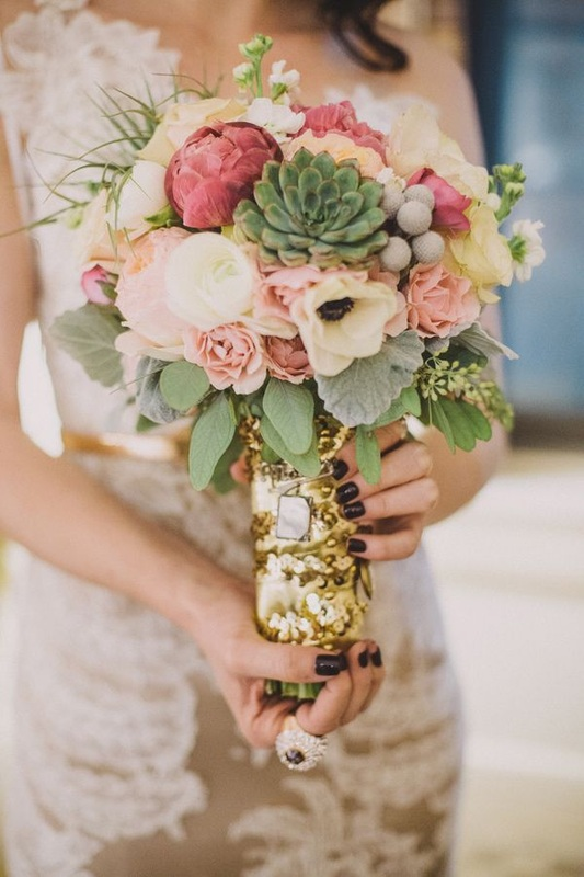 girl holding pink and green bouquet wrapped with gold sequins