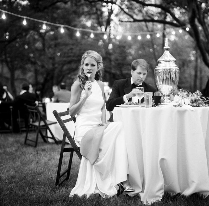 bride and groom eating at outdoor wedding reception