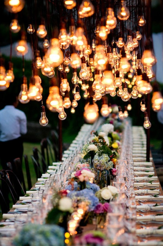 outdoor kings table with hanging edison lights