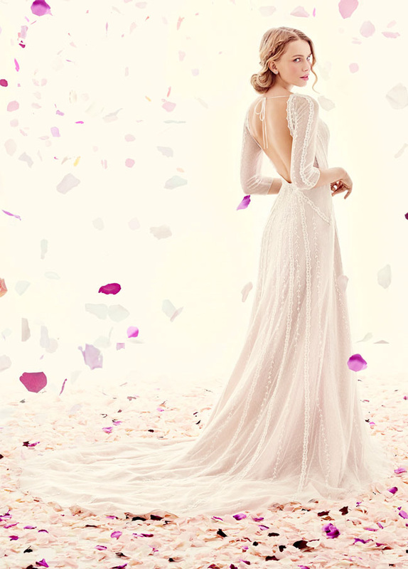 bride in wedding dress with sleeves and open back