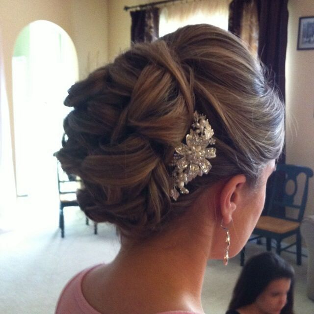 bridal hairstyle up-do in curls and assessory