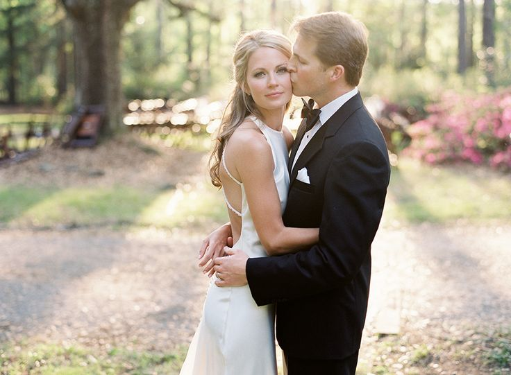 groom kissing bride on the cheek, Cameran Eubanks and Jason Wimberly