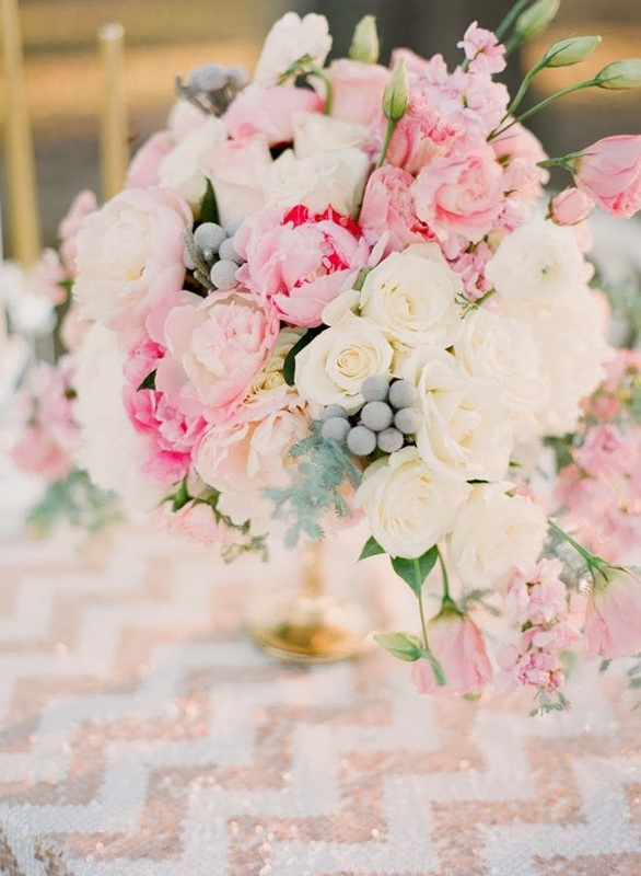pink and white bouquet on white and gold sequin linen