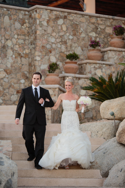 bride and groom entrance into wedding reception, bride in stunning Lazaro wedding dress and hair in an up-do