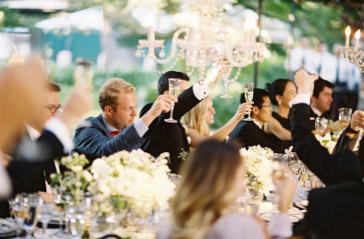 guests toasting at reception table