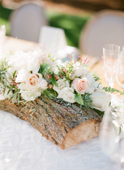 tree branch wedding decor with pastel florals