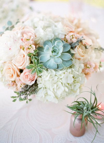 blush and white wedding florals and gold vases with greeneries
