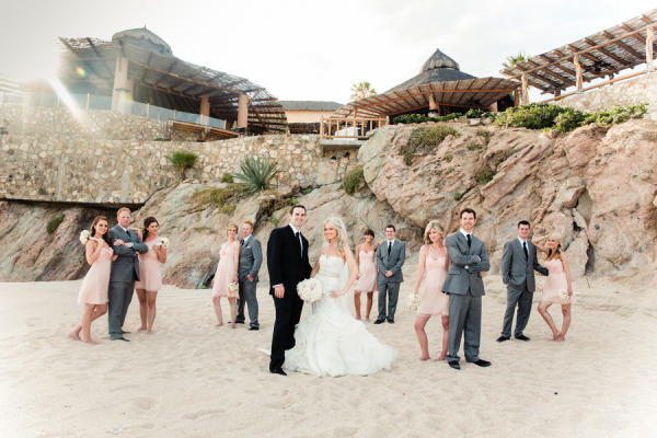 bridal party making funny poses on the beach