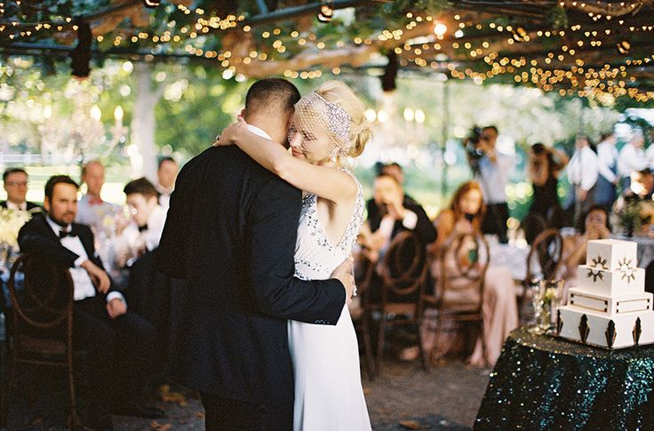 bride and groom first dance while guests eat